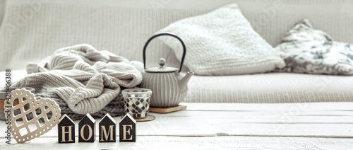 Fotografie, Obraz A teapot with hygge decor details and a decorative word home on the table in the living room