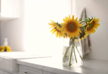 Vase With Beautiful Yellow Sunflowers In Kitchen, Space For Text