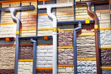 Samples Of Downpipes, Roof And Wall Coatings At Store