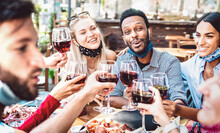 Multiracial People Toasting Wine At Restaurant Garden Wearing Open Face Mask - New Normal Lifestyle Concept About Happy Friends Having Fun Together - Bright Filter With Focus On Guy Looking At Camera