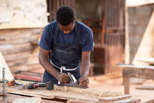 Fotografija portrait of an african carpenter working