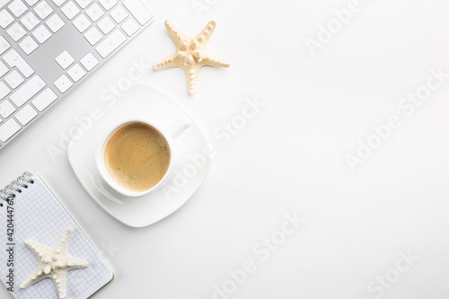 Obraz Cup of coffee with office tools on light background, office flat lay - fototapety do salonu