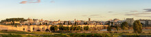 Panoramic Shot Of Badajoz Covered In Buildings And Trees During The Sunset In Spain