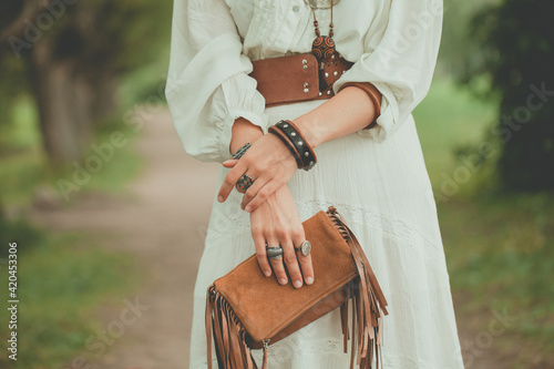 Obraz Brown handbag in the hands of a woman - fototapety do salonu