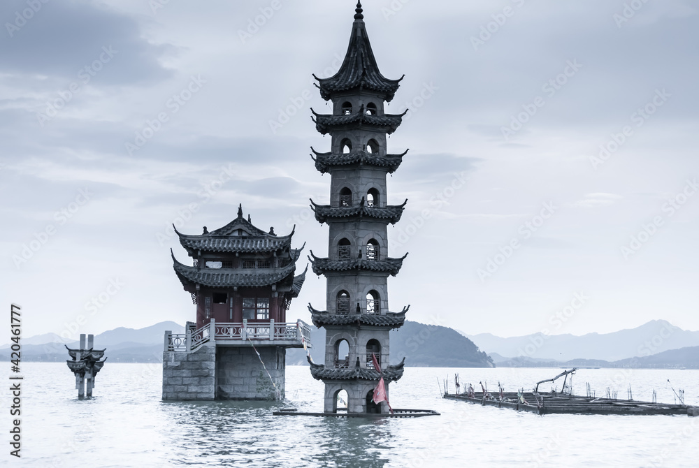Fototapeta The landscape of ancient Chinese architecture archways, pavilions, terraces and towers in the center of Poyang Lake, a submerged spectacle, is located in Jiujiang City, East China's Jiangxi Province.