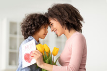 Black Girl Greeting Mom With Tulips And Card