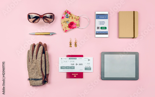 Obraz Background set with mobile covid passport and businesswoman trip accessories - fototapety do salonu