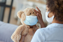 Modern Childhood. Mixed Race Teen Girl Child In Protective Face Mask Holding A Teddy Bear Wearing A Mask