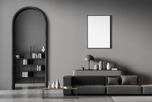 Modern Living Room Interior With Arch And Blank Poster On Wall. Black Sofa With Cushions, Coffee Table, Grey Chest Of Drawers, Bookshelf. Concrete Floor.