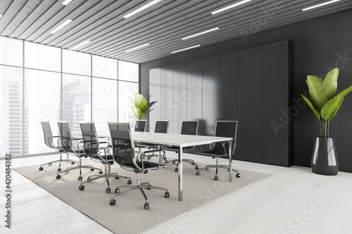 Black and white conference room with furniture and window