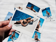 Girl Lying On Edge Of Swimming Pool In Sunlight.