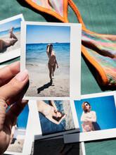 Hand Holding Polaroid Photographs With Girl In Bikini On The Beach