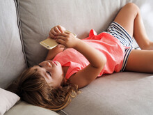 Baby Girl Watching Cartoons Via Cell Phone.