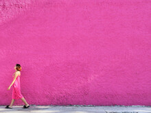 Woman In Pink Against Vivid Pink Wall