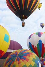 Several Beautiful Hot Air Balloons Taking Off At A Festival