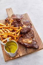 Ribeye Steak With Fries And Mustard