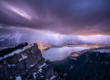 Dark And Rainy Atmosphere Over A Swiss Alps Lake