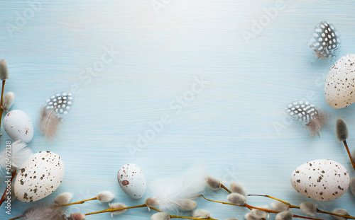 Obraz art Tender Easter greetings banner or card background with decoration Easter eggs and pussy willow on blue wooden vintage planks - fototapety do salonu