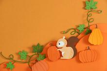 Cute Little Squirrel Investigates A Bright Orange Pumpkin