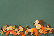 Fluffy Red Squirrel Holds A Nut In Its Paws, Paper Cut Concept