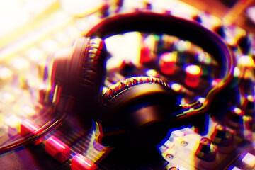 Fototapeta na wymiar Professional dj headphones on sound mixer panel.Disc jockey audio equipment on stage in nightclub