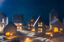 Handmade Small White Cardboard Houses With Illuminated Windows On Snowy.