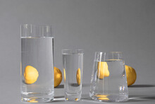 Glasses Filled With Water With Reflections Of Lemons