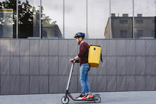 Services Of Food Delivery In Big Modern Town