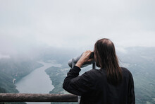 Guy Looking Through A Tower Viewer