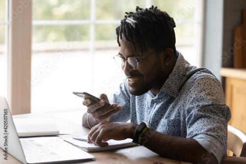 Fotografie, Obraz Enthusiastic african male freelancer make good progress in multitask