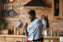 Crazy Cook. Inspired African American Male Relax Having Fun Sing Favorite Song Dance By Music At Kitchen Counter Make Microphone From Tools. Positive Funny Black Hipster Guy Cooking Food With Feeling