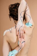 Anonymous Woman With Creative Bodyart