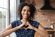 canvas print picture - I love you. Portrait of thankful young african lady blogger appreciate for support of vlog channel hold fingers joined in like sign. Headshot of loving black female looking at camera show heart symbol