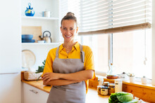 Smiling Adult Woman In Own Modern Kitchen