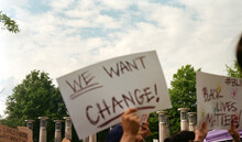 We Want Change Protest Sign