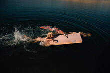 Children Swimming With Toy Raft