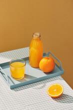 Glasses Of Fresh Orange Juice With Sliced Orange