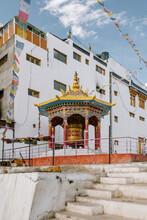 Prayer Drum Inside The Courtyard Of A Buddhist Monastery