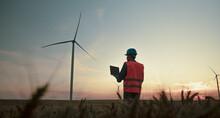 Engineer Checking Windmill Farm System