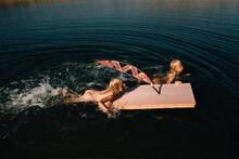 Children With Toy Raft
