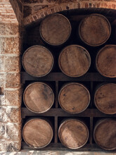 A Stack Of Rum Barrels In A Brick Room