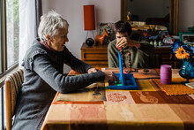 Mother Playing Game With Disabled Daughter