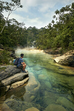 Man In The Rainforest Watching An Stunning River