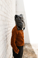 Person With Hiding Under Trash Bag Face Mask