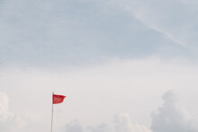 Red Flag On The Sky