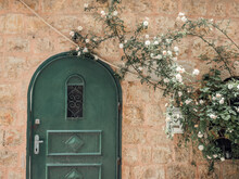 An Old Green Door With Flowers In Jerusalem