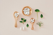 Capsules Organic Herbal Powder On Wooden Spoon. Alternative Multivitamin For Health Care Eating In Living Life
