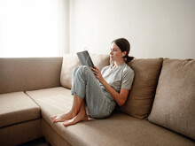 Woman With Tablet Gadget At Home