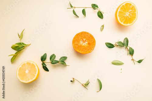 Fototapeta Fruit background. Colorful fresh fruits on white table. Orange,  lime, lemon, grapefruit. Flat lay, top view, copy space obraz