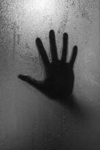 Hand Shadow Behind Glass